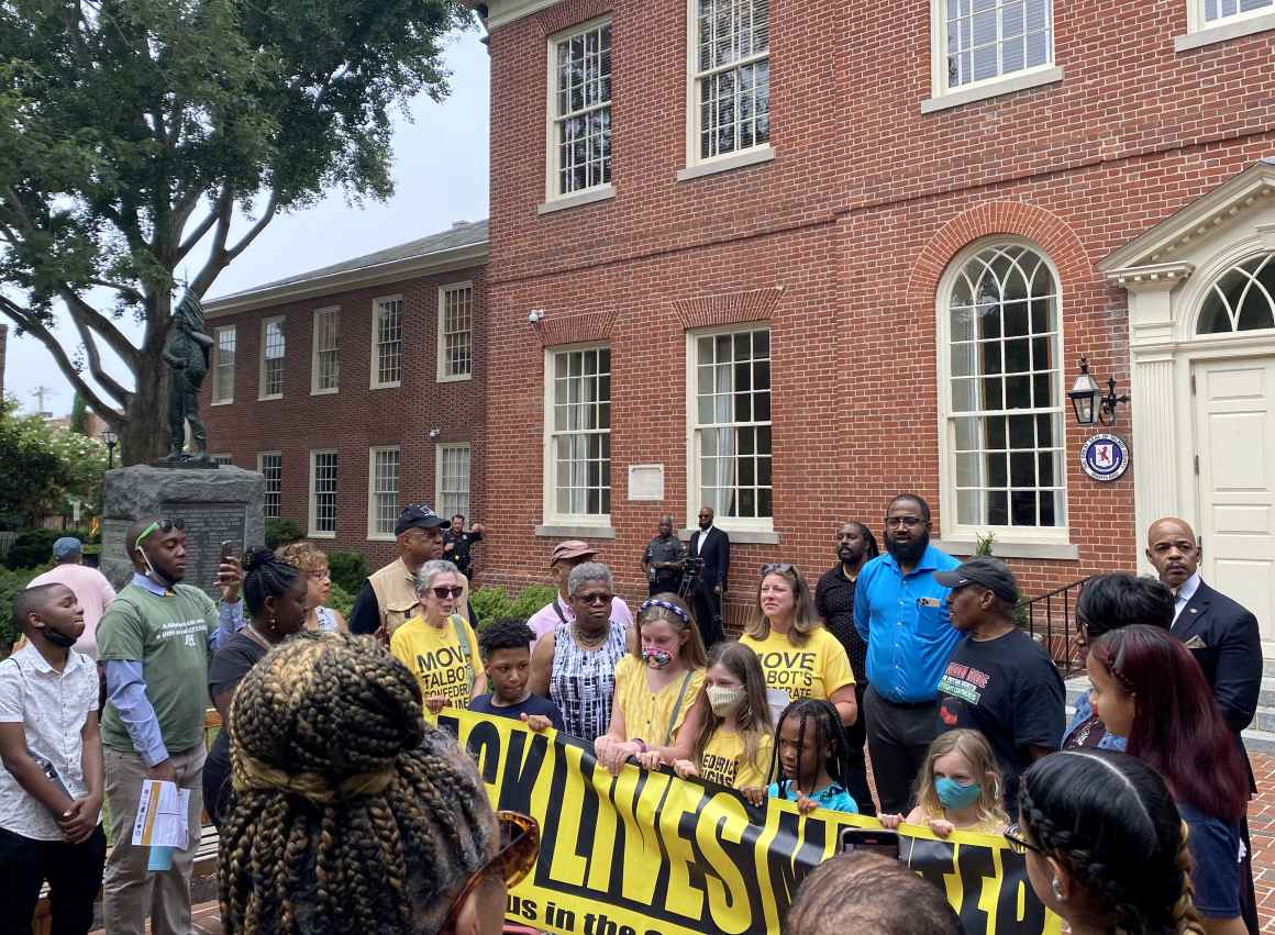 2021 Freedom Riders protest at courthouse in Easton, Maryland, next to a Confederate statue. The protesters hold a Black Lives Matter banner.