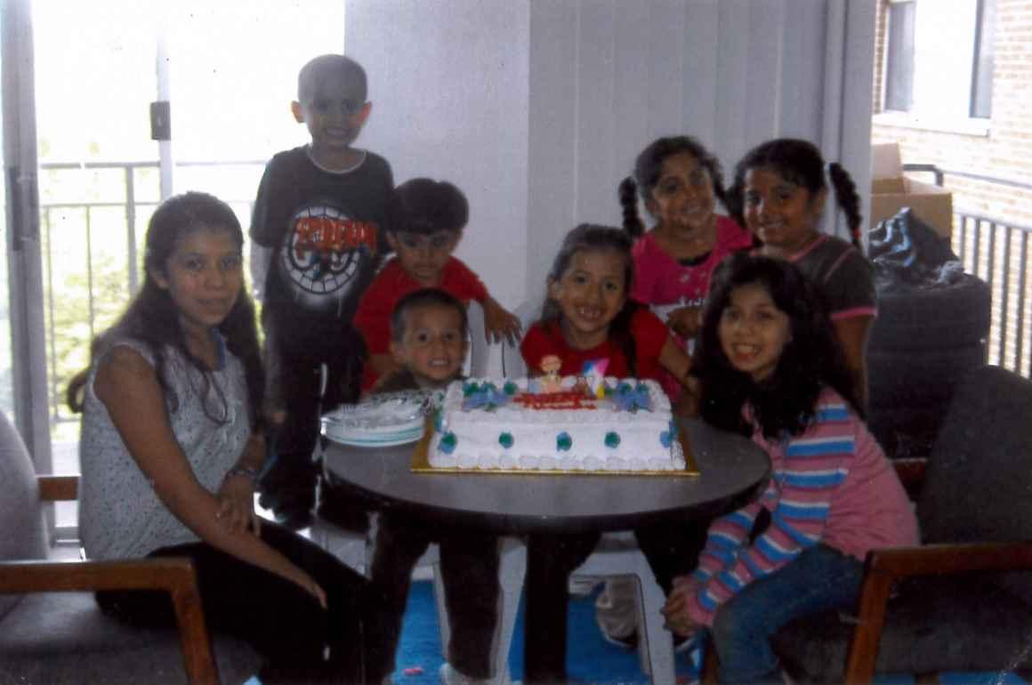 Neydin Milián and family celebrating her cousin's birthday
