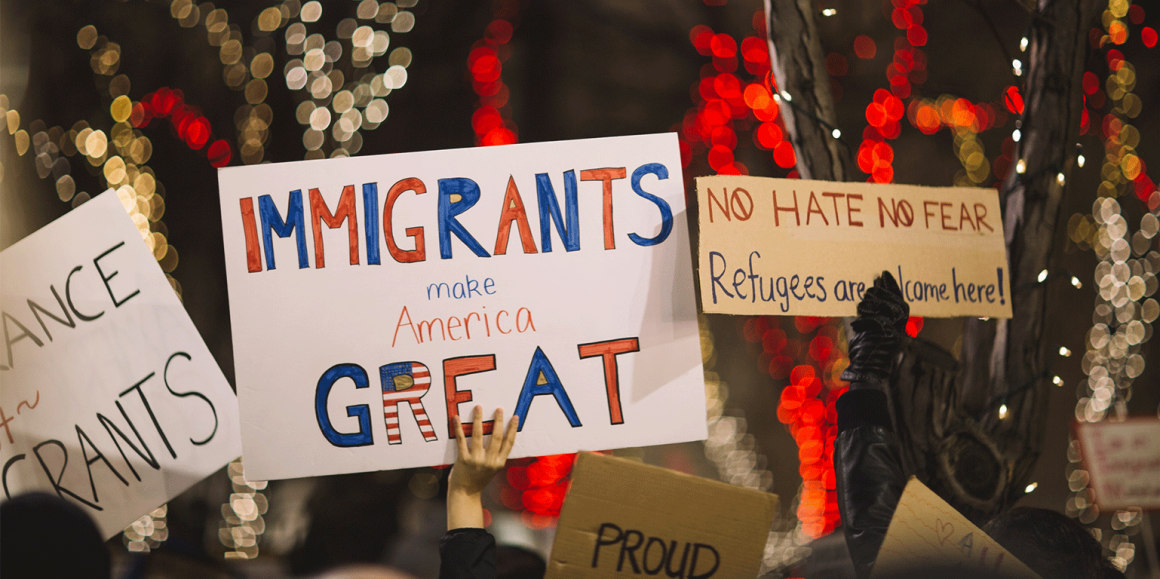 """Immigrants Make America Great"" protest sign"