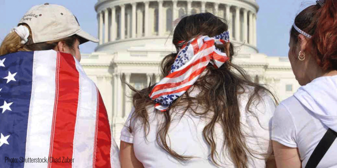 3 Latinx people with American flags