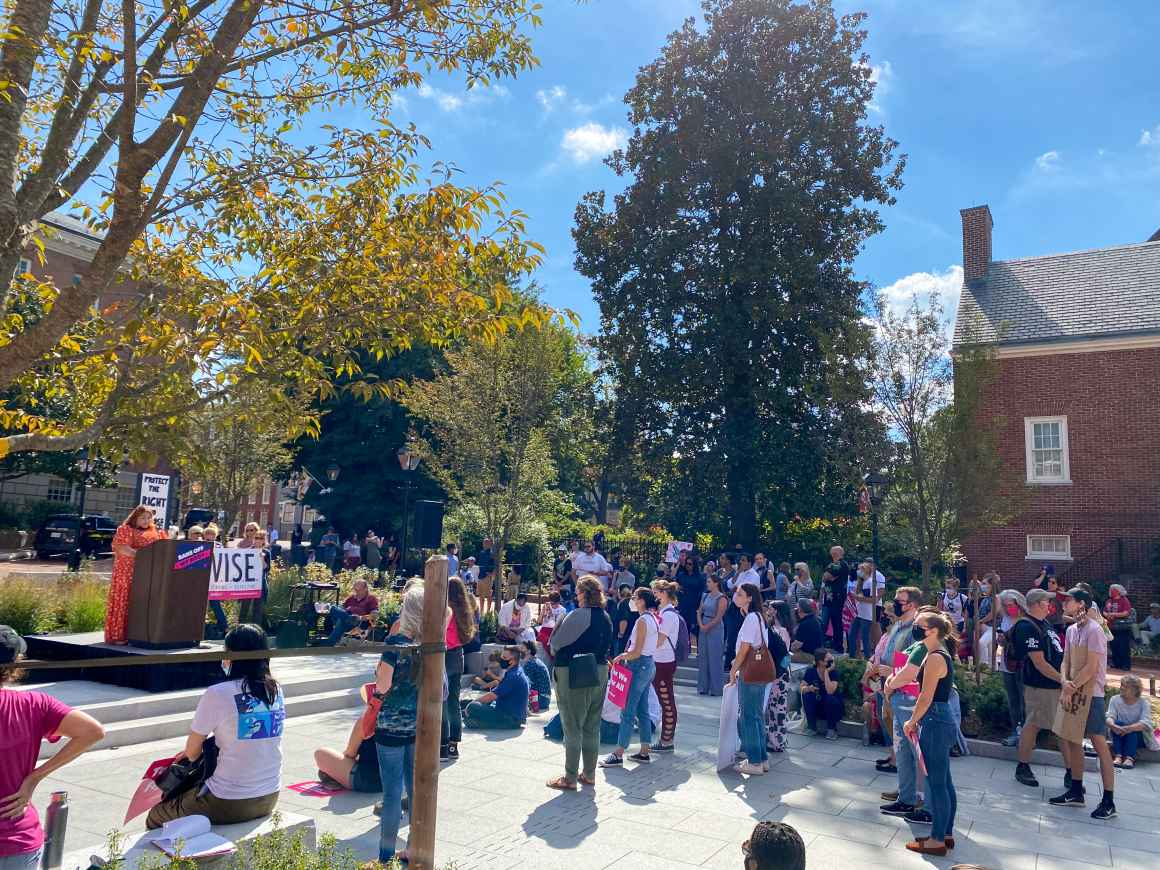 Wide angle view of the crowd at the abortion access rally in Annapolis on October 2, 2021. Lorena Diaz is at a podium giving remarks.