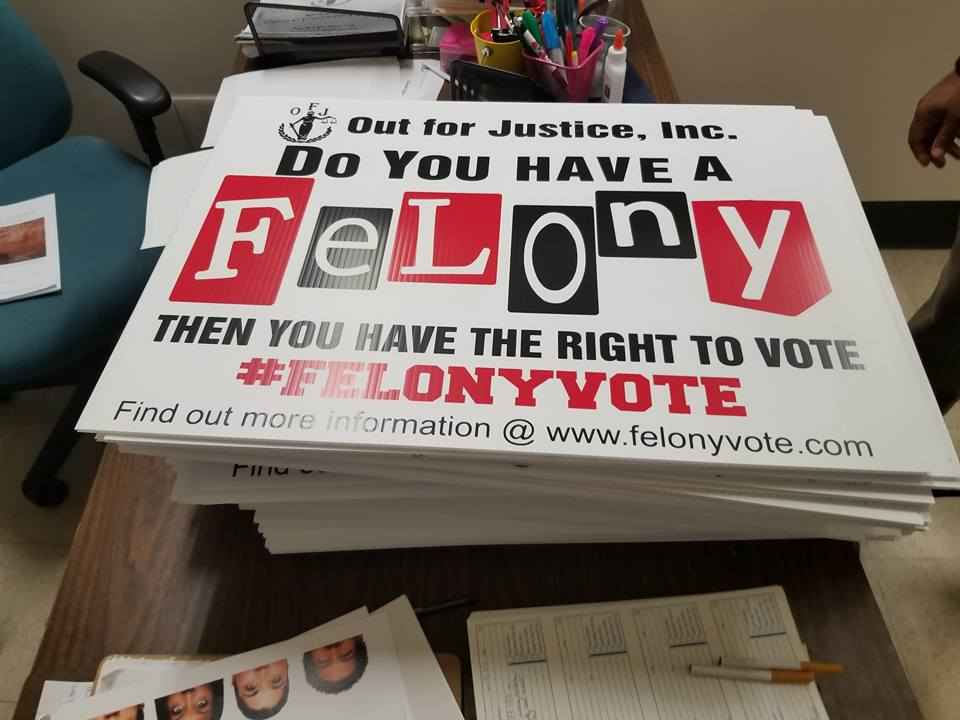"""A protest sign from Out for Justice, Inc. that says"""" Do you have a felony? Then you have the right to vote."""""""