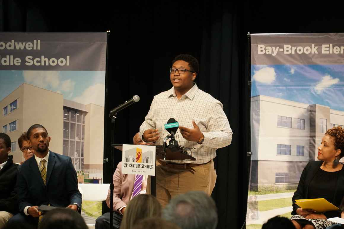 Bryce Taylor is a member of the Baltimore City Student Media team and is on stage delivering a speech at the school opening at Bay-Brook Elementary/Middle School in Baltimore, Md.
