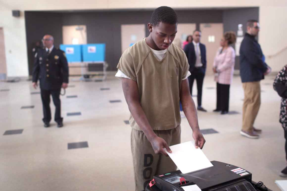 A Black person who is currently incarcerated is in the process of voting.