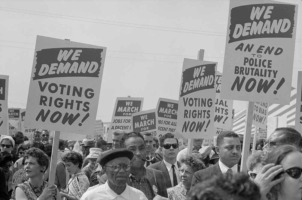 Marchers with signs at the March on Washington in 1963.