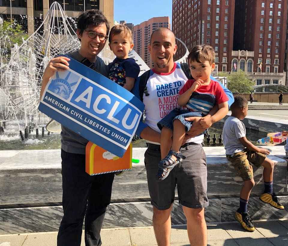 Sergio Espana and Nick Taichi Steiner with their children at Sanctuary DMV rally