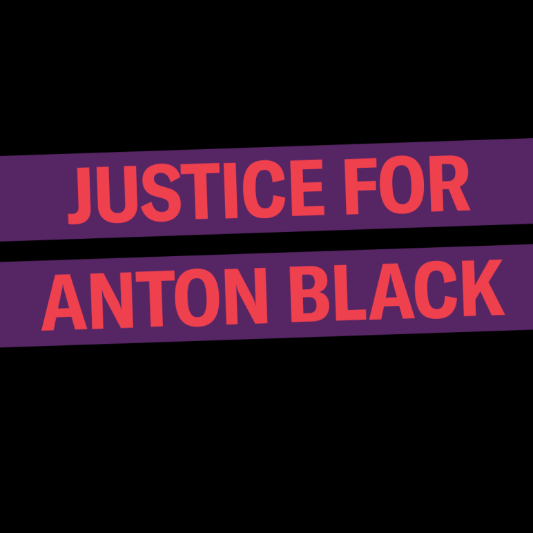 Justice for Anton Black. The background is black, the words are red in a purple rectangle that is slightly tilted up.