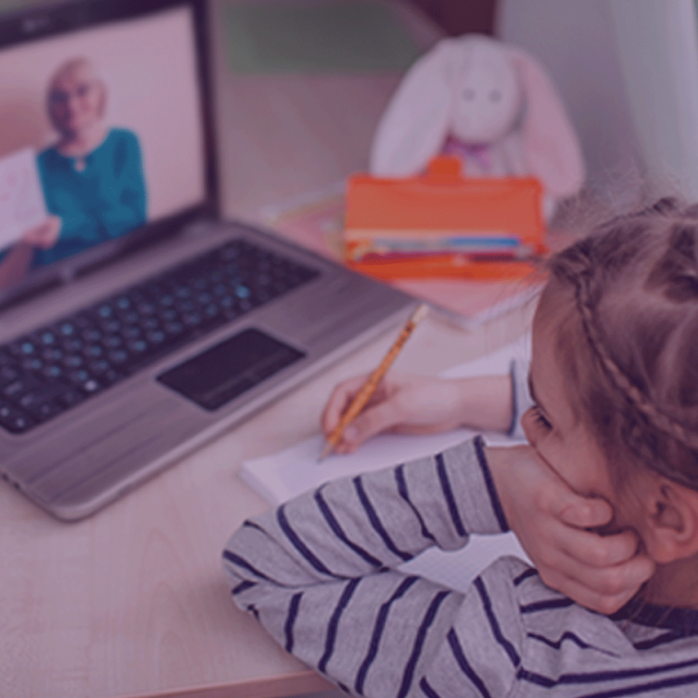 Child distance learning in front of a laptop.