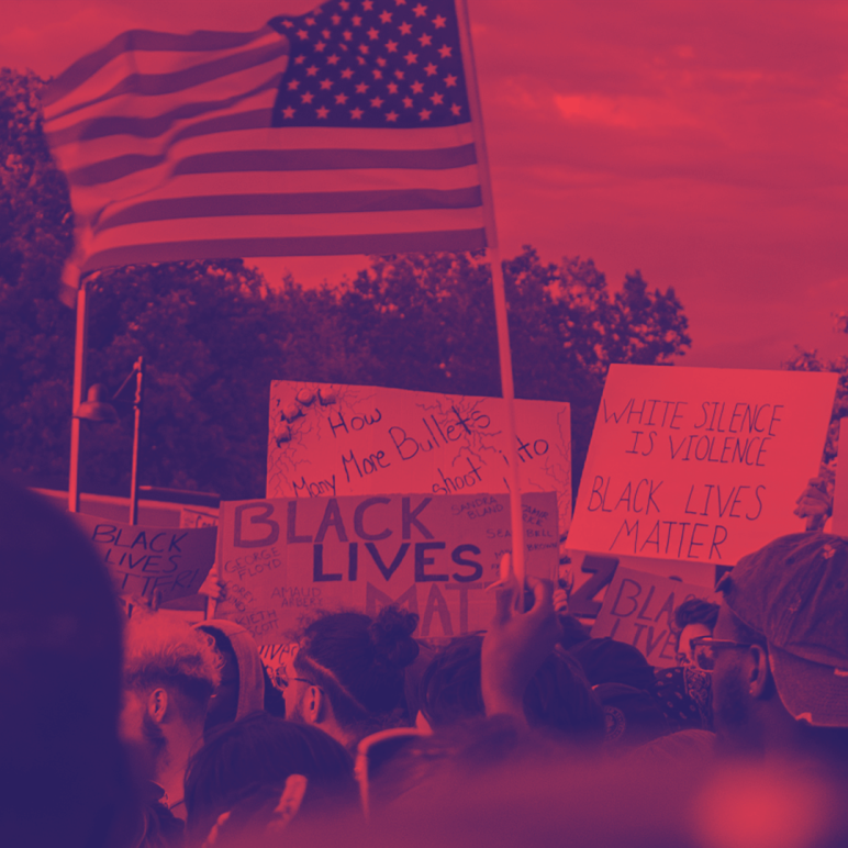 Image shows a protest for Black Lives Matter with a red and navy blue filter on it. People are holding a flag and protest signs.