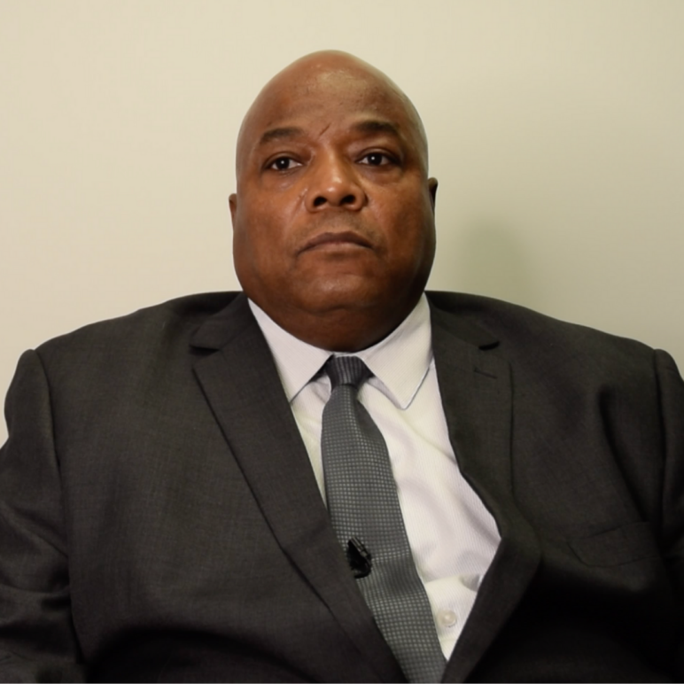 Chief Sewell looking serious in a black suit