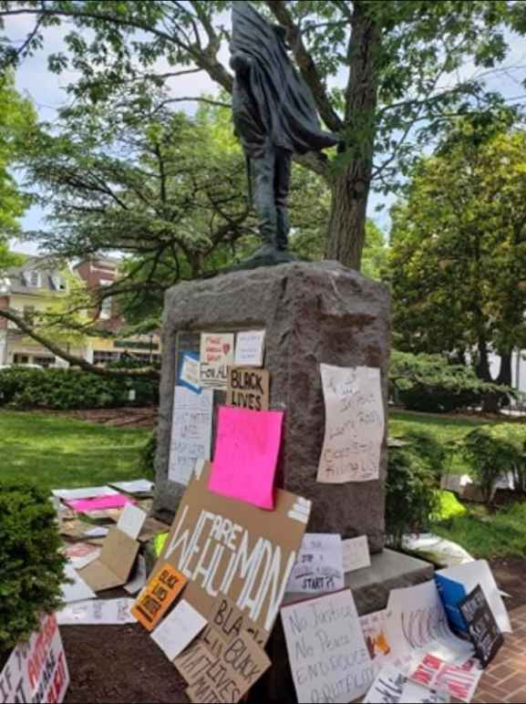 Talbot County Confederate statue is in the center and the base is surrounded by protest signs.