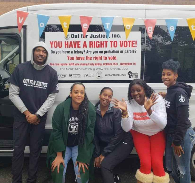 "Expand the vote coalition group of people in front of a van with a sign that says, ""You have a right to vote!"""