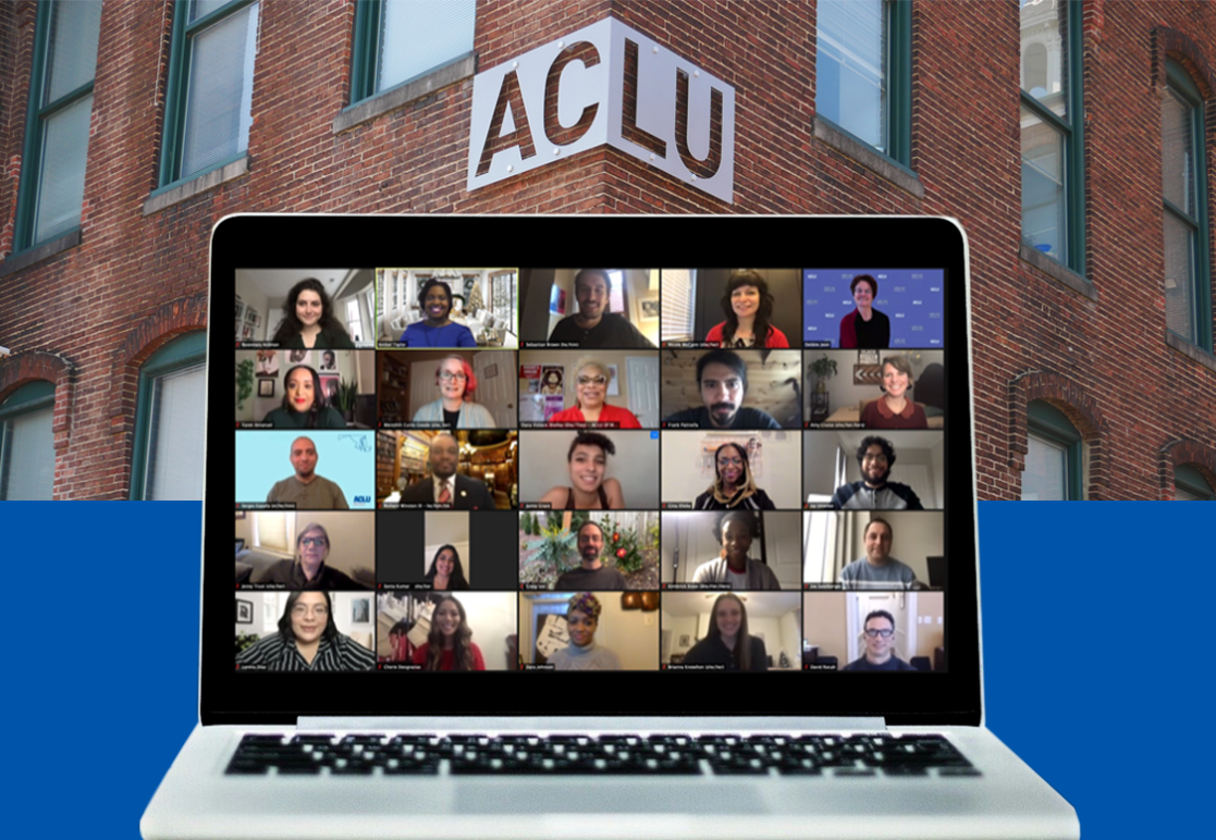 ACLU of Maryland 2020 group staff photo on Zoom shown on a laptop. The background is the ACLU-MD brick building with sign.