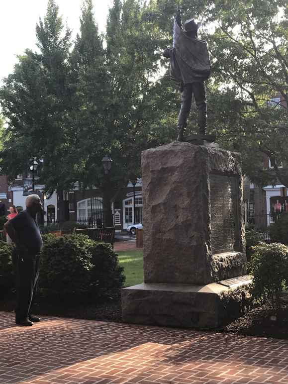 A Black man looks at the Talbot County Confederate statue in Easton, Maryland.